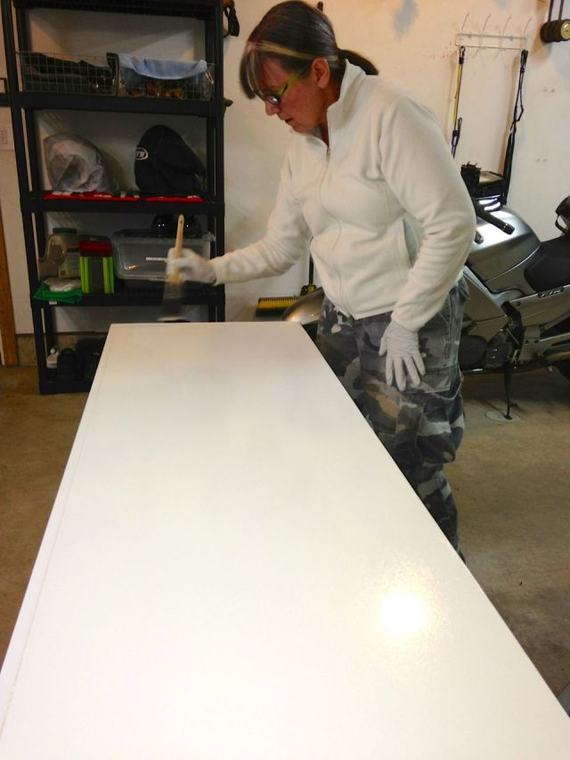 Suzie applying the white paint